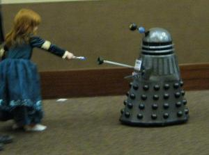 Dalek with girl and sonic screwdriiver